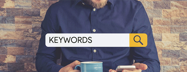 Large search bar with the word keywords with a man in the background